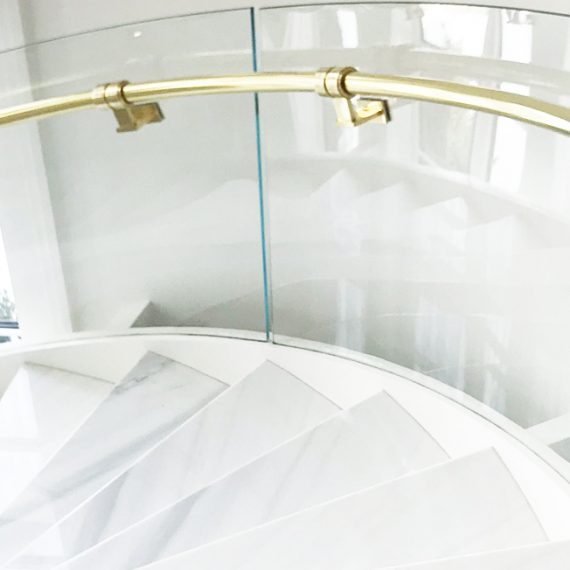 curved glass railing on stairs
